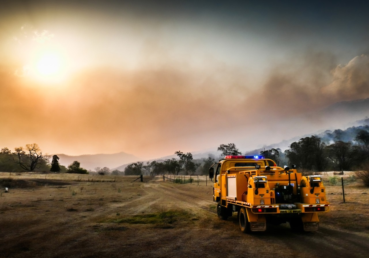 Rescue truck driving through dry bushland; image used for HSBC Australia bushfire support.