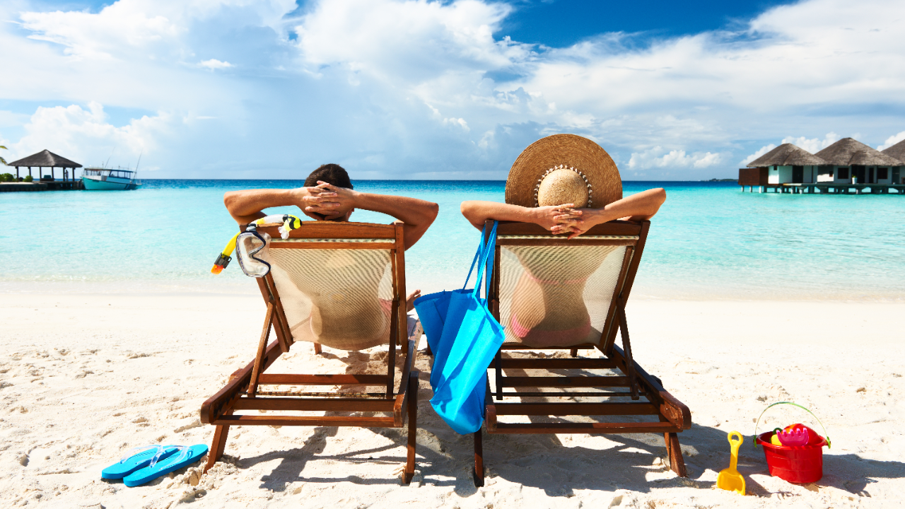 A pair of couple relaxing on beach chairs; image used for HSBC Home&Away.