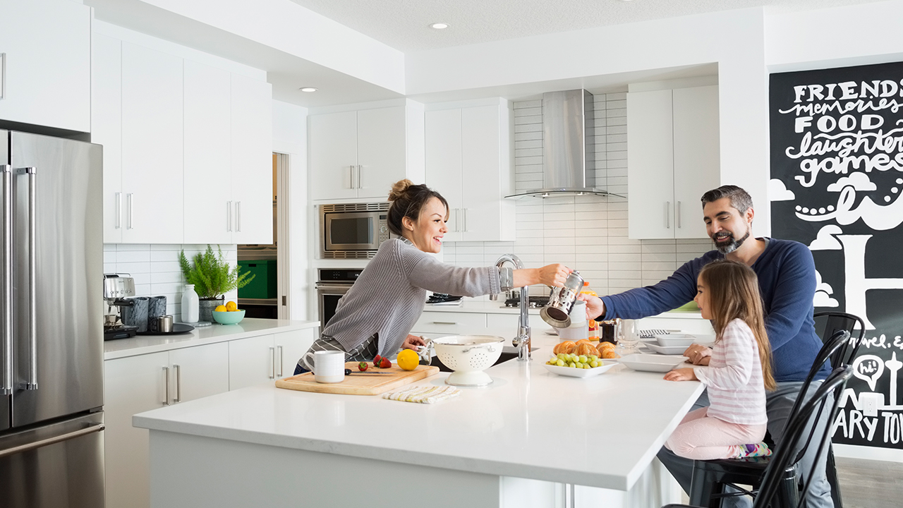 Family having breakfast in the kitchen; image used for HSBC Home and Contents insurance page.