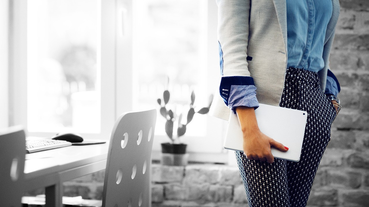 Holding a laptop on hand; image used for HSBC Australia  personal loans page.