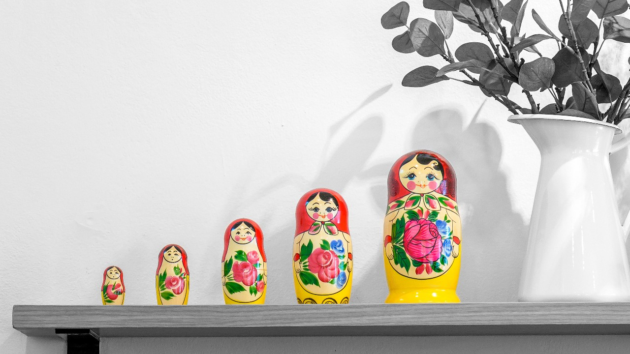 A set of matryoshka dolls displacing on shelf; image used for HSBC Compare Savings Accounts page.