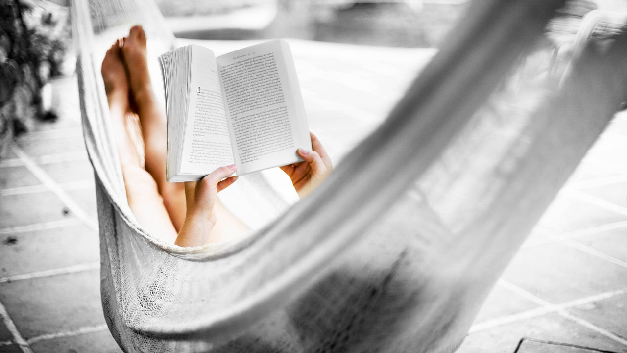 Reading and relaxing in hammock outdoor; image used for HSBC Australia Platinum Credit Card