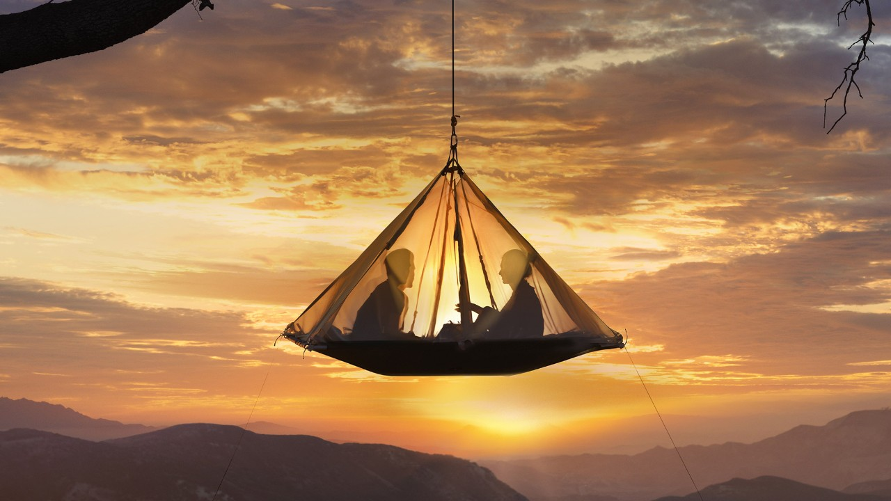 Sitting in a tent during sunset; image used for rewards page.
