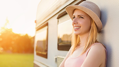 A woman standing by a camper van; image used for HSBC travel insurance page.