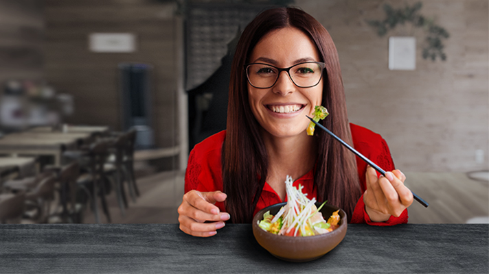 A woman is having salad in a restaurant; image used for HSBC Australia Serious Saver Account page.
