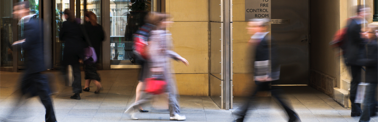 People walking on street; image used for Investing in Australia or overseas.
