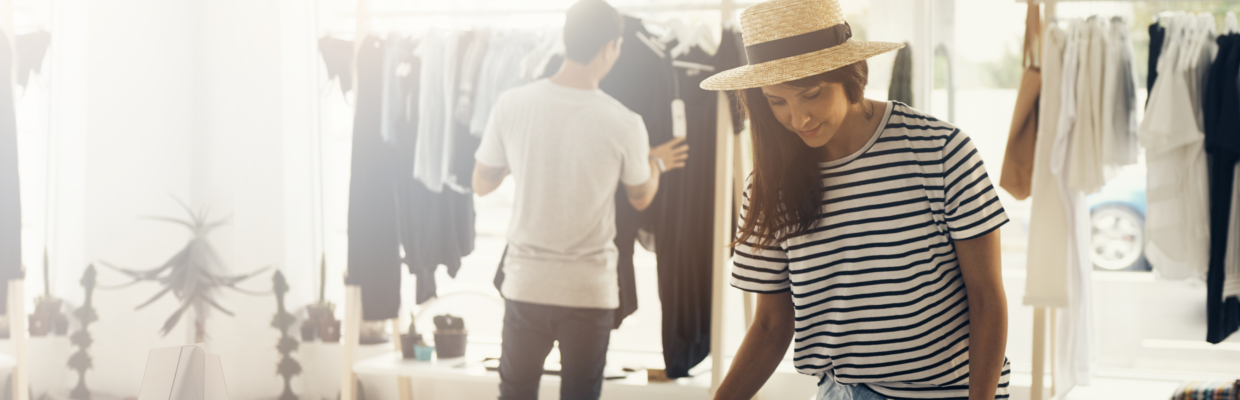 Woman in striped sweater and straw hat in a clothing store; image used for HSBC day to day account page.