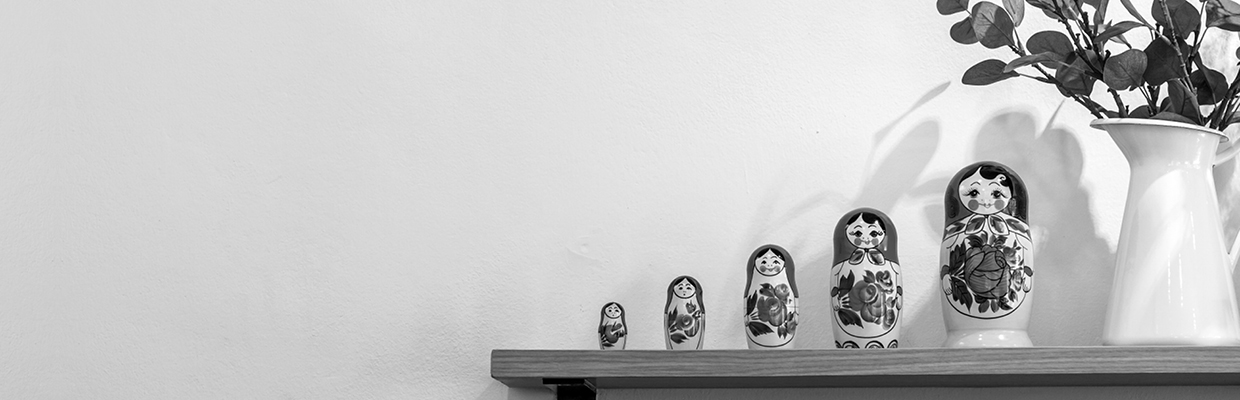 A set of matryoshka dolls displacing on shelf; image used for HSBC Australia Savings Accounts page.