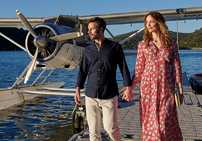 Couple walking next to seaplane; image used for HSBC Platinum Credit Card offer.