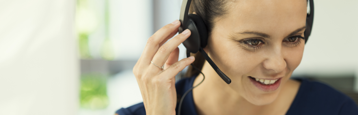 A woman is talking on headset; image used for HSBC Australia Help page.